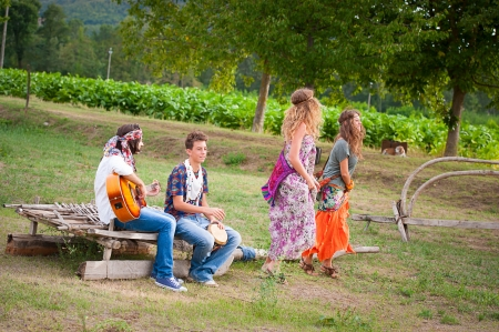 Hippie Group Dancing in the Countryside,Italy photo