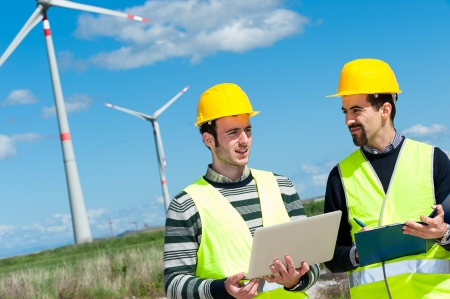 Two Engineers in a Wind Turbine Power Station, Italy Stock Photo
