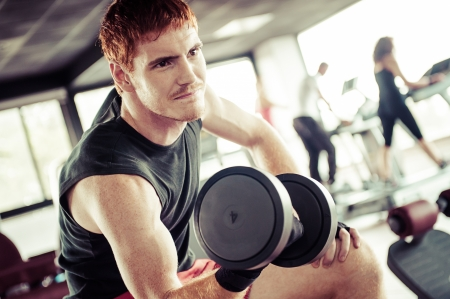 dumb: man with weight training equipment on sport gym club,Italy Stock Photo