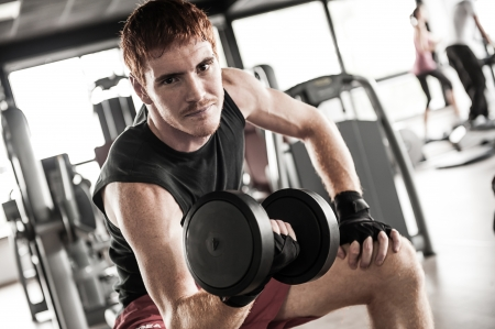man with weight training equipment on sport gym club,Italy Stock Photo