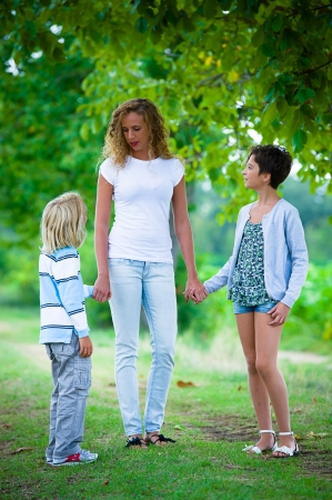 Beautiful Young Woman with Two Children Outside,Italy photo