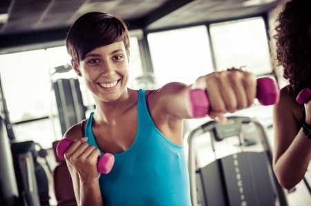 fitness club: Running on treadmill in gym or fitness club - group of women and men exercising to gain more fitness
