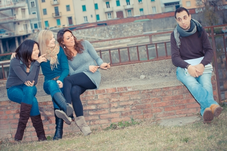 Male Student get Mobbed by the Group Italy Stock Photo