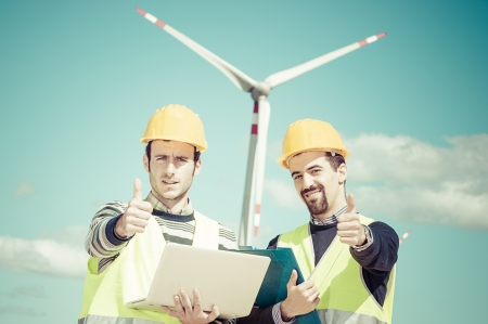 Two Engineers in a Wind Turbine Power Station, Italy photo
