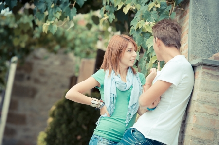young couple having fun in the park,Italy photo