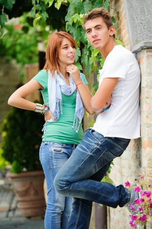 teen couple: young couple having fun in the park,Italy