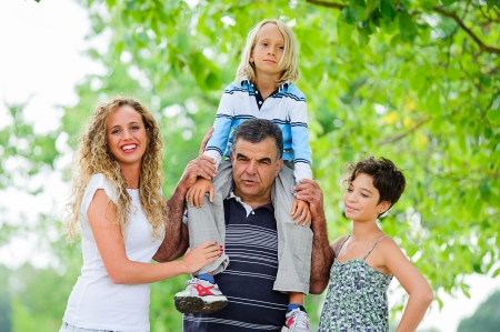 three generations: Happy Three Generations Family Outdoor,Italy Stock Photo