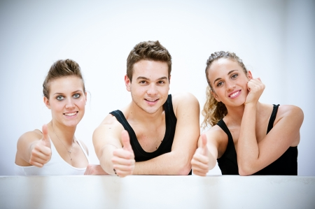 Three Smiling Persons after Fitness Exercises with thumbs up,Italy Stock Photo