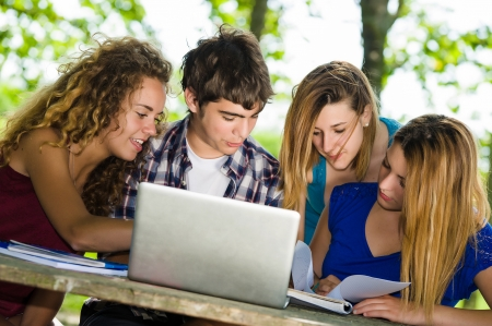 Group of young student using laptop outdoor,Italy Standard-Bild