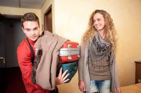 Bellhop Moving Heavy Luggage,Italy Stock Photo