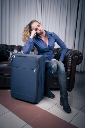 weary: Young woman, resting her head on a suitcase, weary from traveling,Italy Stock Photo