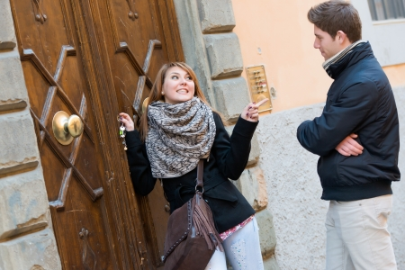 Man and Woman in front of Home Main Entrance,Italy photo