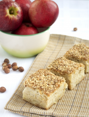 honey apple: Pieces of honey apple pie, apples and hazelnuts