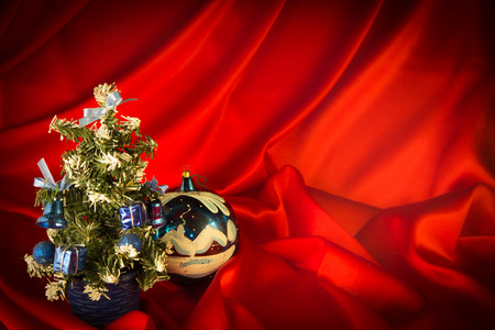 fiery-red background for congratulations on Christmas and New Year with different toys Stock Photo