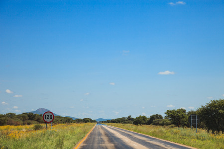 savannas: South African road through the savannas and deserts with markings and traffic signs. South Africa. Namibia. Stock Photo