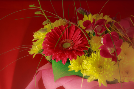 beautiful bouquet of gerbera flowers and chrysanthemum on a different background. Ikebana made of a different color Stock Photo