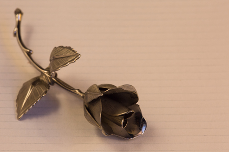 floret: Metal rose on a background for holiday greetings