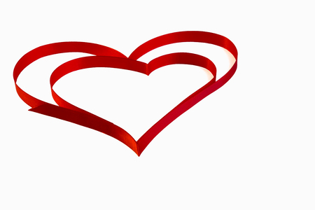 isolated heart of red ribbon on a white background for the  Valentines holiday