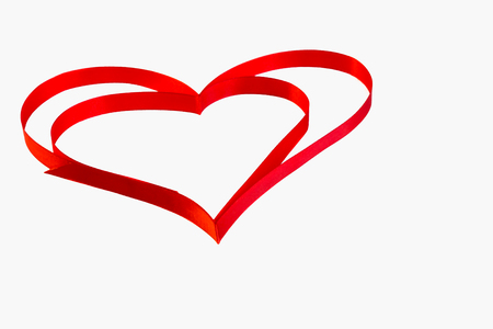 february 1: isolated heart of red ribbon on a white background for the  Valentines holiday