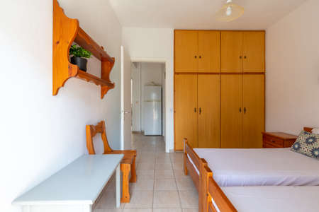 organization of a sleeping, rest and cooking space in the hotel apartments for seasonal rest for tourists at the sea in places of relaxation in sunny southern European countries Greece, Spain Éditoriale
