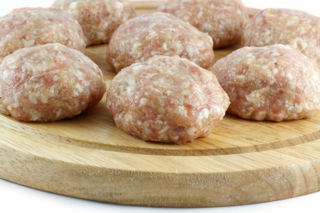 Balls of minced meat on a kitchen board photo