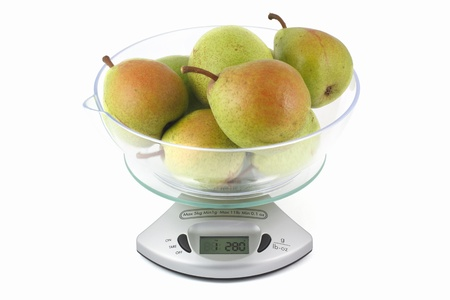 pears weighed on kitchen scales Stock Photo - 16815494