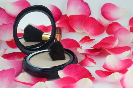 Powder and brush and rose petals