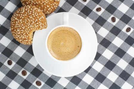 Coffee and cookies on a checkered tablecloth photo