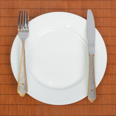Place Setting with Plate, Knife   Fork photo