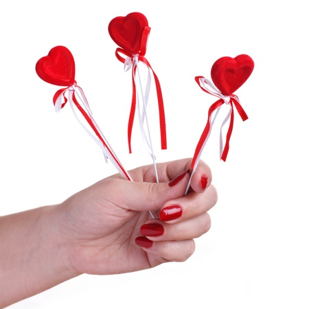 Three red hearts in a female hand photo
