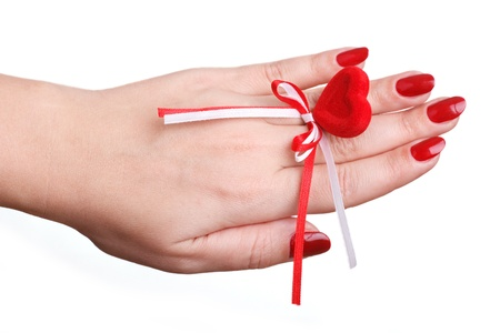red manicure and red heart photo