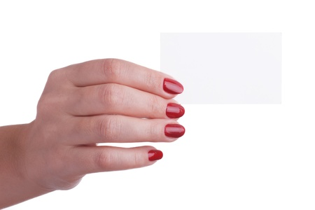Female hand with red manicure holding a business card photo