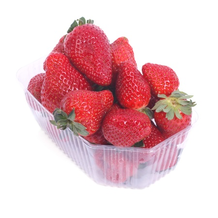 fresh juicy strawberries in a plastic box isolated on white Stock Photo - 18140257