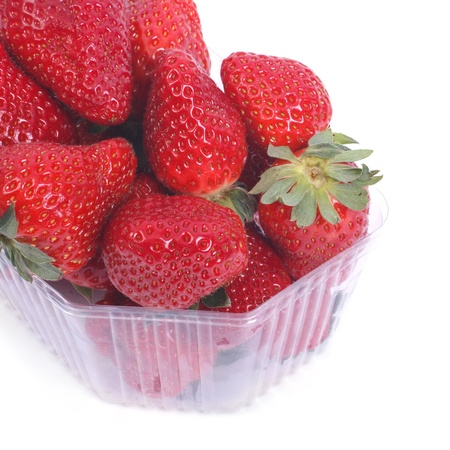 fresh ripe juicy strawberries in a plastic container isolated photo