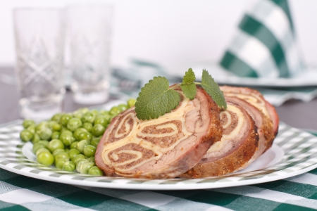 Table setting. Meatloaf, garnished with green peas, mint sprig Stock Photo - 18366826