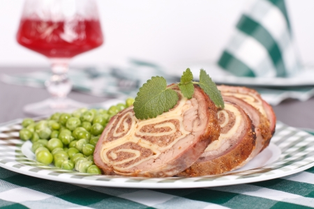 Meat stuffed with cheese, garnished with green peas Stock Photo - 18366827