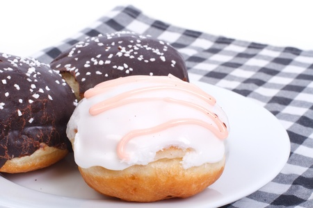 Three delicious fresh donuts in the glaze on a napkin  Stock Photo - 18936855