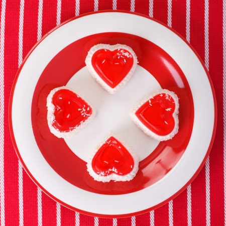 cheesecakes in heart on a striped tablecloth  top view photo