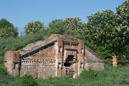 growers: old brick Growers overgrown with grass