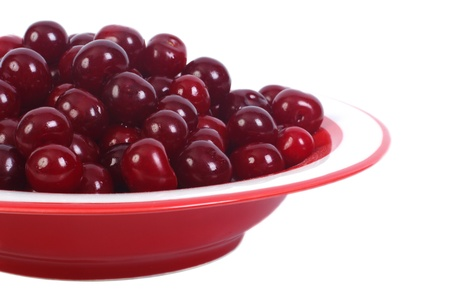 ripe cherries in a bowl isolated on a white background  close-up photo
