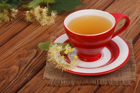 linden tea: Herbal tea with a linden on a napkin in a rustic style Stock Photo