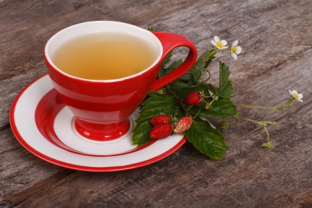 Herbal tea with berries and flowers of wild strawberries photo