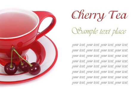 Fruit tea with cherry in a red cup isolated on white background