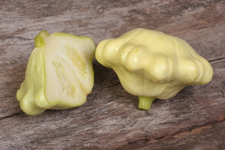 two ripe pattypan squash on a wooden old table photo