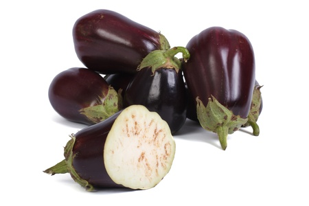 plenty of ripe eggplant and one aubergine sliced Stock Photo - 21915658
