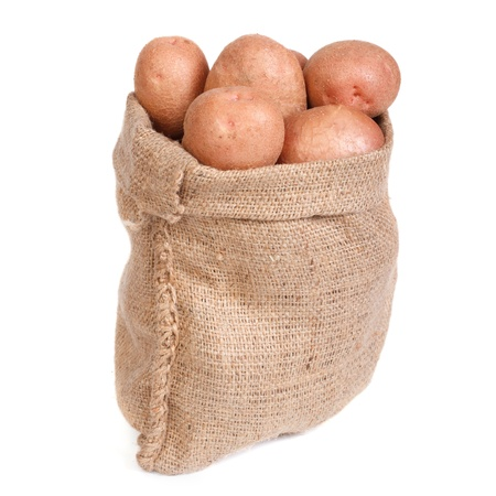 fingerling: Ripe potatoes in the bag isolated on white background