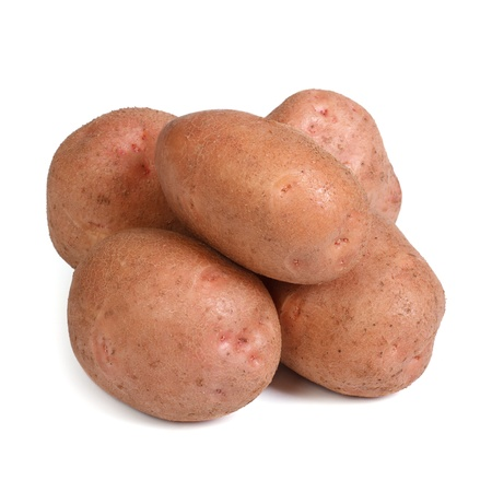 desiree: Tubers of red potatoes isolated on a white background  close-up