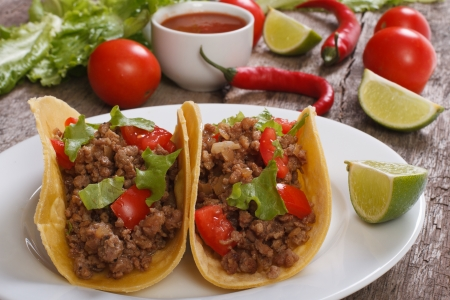 Tacos stuffed with ground beef and chili sauce