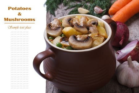 Potatoes with mushrooms and green peas in a pot  photo