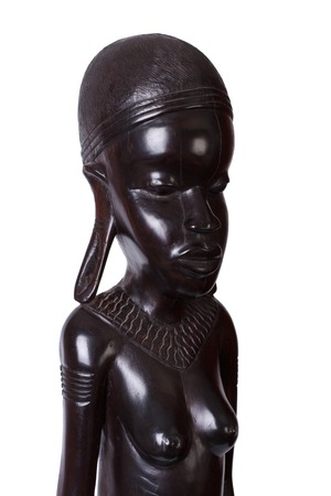 African woman carved from ebony wood isolated on white photo